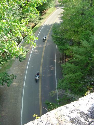 Photo - two motorcycles passing beneath Backbone Rock, TN